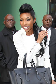 Brandy wore her hair in an ultra-long ponytail with bouffant bangs for an appearance on 'Good Morning America.'