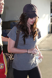 Megan Fox was all about trying to travel incognito. She wore a baseball cap and nondescript gray tee-shirt while walking through LAX.
