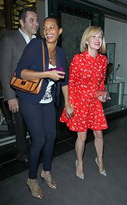 Amanda Holden carried a petite metallic clutch to dinner at Ivy.