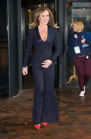 Amanda Holden took the black suit to a new level of glamour with wide legs and a plunging neckline at 'Britain's Got Talent' auditions in Glasgow.