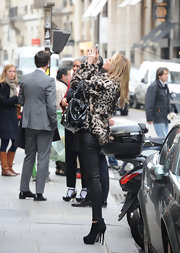 Abbey Clancy wore killer suede ankle boots while shopping in Paris.