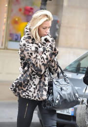 Abbey Clancy bundled up in Paris with a glam faux leopard print coat.