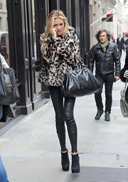Abbey Clancy showed off her thin pins in tight leather pants.