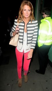 Millie Mackintosh was spotted during a date night wearing a Sandro fringed tweed jacket on top of white tank paired with pink skinny jeans.