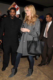 Brooklyn Decker gave her cold weather attire a futuristic touch with pointy black and gray suede ankle boots.