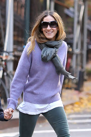 Sarah Jessica Parker knotted a gray scarf around her neck while out in NYC with her son.