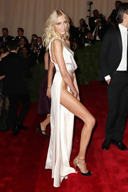 Anja Rubik must have been the center of attention at the Met Gala in this super sexy evening dress and two-tone peep-toes combo.