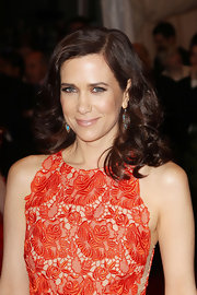 Kristen Wiig wore her parted tresses in long luxe curls at the Met Gala.