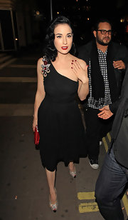 Dita flaunts a perfect red moon manicure.