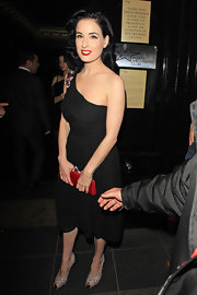 Dita Von Teese looked radiant holding onto her red clutch. The crimson clutch matched Dita's signature red lips perfectly and feature gem encrusted shoe clasps.