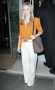 Kristen Bell looked polished in head to toe Ferragamo. She carried a luxe brown suede cross body purse by the designer.
