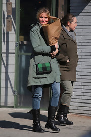 Cameron Diaz opted for a green and black plaid bag for a bit of color while running errands in NYC.