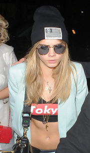 Cara Delevingne looked totally grunge-chic in this black knit beanie while hanging out with bestie, Rita Ora.