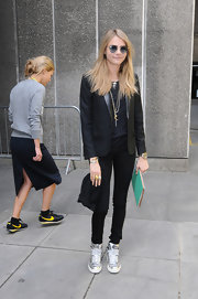 Cara Delevingne chose a sleek blazer to pair with her skinny pants at the 'Vogue Festival.'