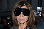 Carine Roitfeld's ultra-modern aviators gave off a serious blackout effect.