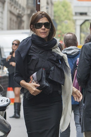 Carine Roitfeld was spotted during Paris Fashion Week carrying a cute Givenchy Bambi clutch.