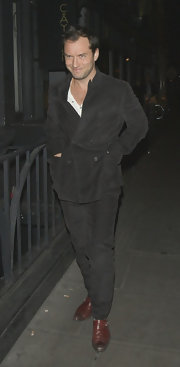Jude Law opted for brown on brown when he paired this brown suede coat with matching pants.