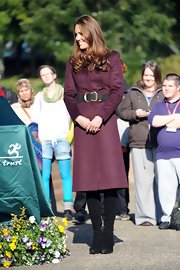 Kate Middleton's classic suede boots matched the polished feel of her plum jacket.