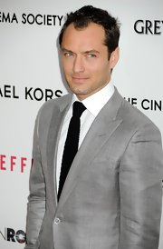 A classic solid black tie popped on Jude Law when paired with a silver suit and crisp white button down.