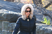 Catherine Zeta-Jones swiftly dumps a cigarette in a pile of dry leaves after realising photographers are in Central Park. Catherine's husband Michael Douglas is currently recovering from chemotherphy and radiotherapy treatments for stage IV throat cancer.