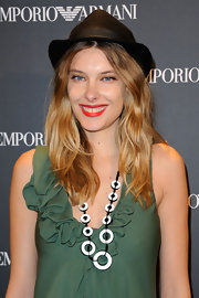 Sara Brajovic celebrated the Emporio Armani boutique opening in Paris wearing this statement necklace and pea green dress.