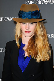 Zoe Le Ber wore a feather-adorned fedora for the Armani store opening in Paris.
