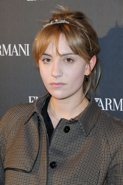 Lolita Chammah wore her hair in a simple updo with a sweet skinny headband at the Emporio Armani store opening in Paris.