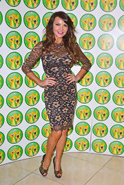 Lizzie Cundy showed off her curves in a floral lace cocktail dress while at the Wetnose Animal Awards.