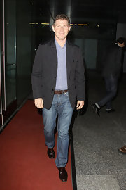 Bobby Flay paired his classic jeans with a black blazer.