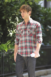 Chace rocked a plaid button down shirt which he paired with classic jeans.