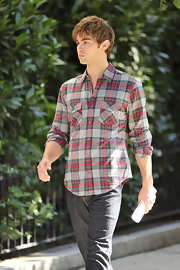 Chase Crawford showed off a plaid button down shirt while on the set of 'Gossip Girls'