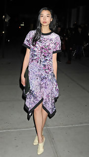 Lily Kwong topped off her asymmetrical frock with ivory ankle boots.