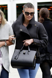 Charlize Theron carried a structured leather tote to the movie theater.