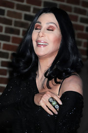 Cher added some curls to her trademark center-parted hairstyle for her visit to 'Letterman.'