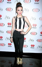 Cher Lloyd was sporty-sexy in gold basketball sneakers, skinny jeans, and a crop-top during the iHeart Radio Festival kickoff party.