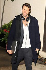 Howard Donald kept warm in a navy wool coat after a performance on 'The X Factor.'