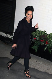 Rebecca Ferguson covered up in a simple black wool coat as she left the 'X Factor' studios.