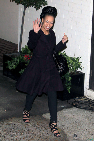 Rebecca paired a ladylike wool coat with strappy black sandals and her trademark smile. The sassy heels feature snakeskin cuffs for a sultry touch.