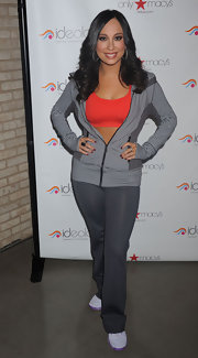 Cheryl Burke attended the launch of Ideology in a pair of tight gray workout pants.