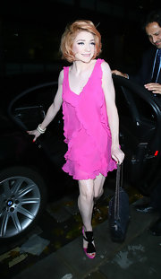 Nicola Roberts was a dream in pink platforms. The precious heels feature large black bows and matched her ruffled frock perfectly.