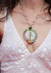 Chloe paired her open neckline with a gemstone pendant necklace with multi-color stones.