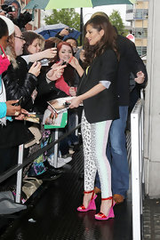 Cheryl Cole stopped BBC Studios in London wearing a pair of red and fuchsia wedges.