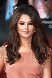 Cheryl Cole added major volume to her look by teasing her crown. Center part bangs helped frame her face, while honey-blond highlights finished off her look.