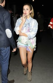 Caggie Dunlop was spotted out at a bar in Chelsea wearing short shorts and a washed denim jacket.