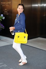 Bailee Madison carried a neon messenger bag as she left her NYC hotel.