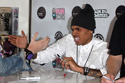 Chris Brown gave an enthusiastic high-five while wearing an oversized black beanie.