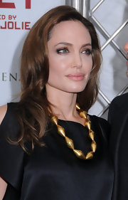 Angelina Jolie wore her hair in soft, shiny waves at the premiere of 'In The Land of Blood and Honey.'