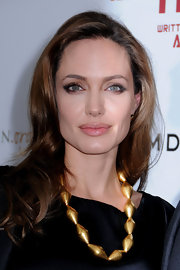 Angelina Jolie kept her makeup look minimal with neutral shadows and a light application of gloss at the premiere of 'In The Land of Blood and Honey.'