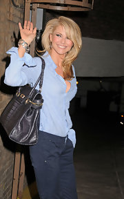 Christie Brinkley carried a sophisticated structured Margaux bag in black outside of the Ambassador Theatre.