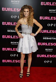 AnnaLynne McCord glimmered in metallic Christian Louboutin Ambertina sandals. She paired the glittery buckled sandals with a silver cocktail dress and lots of curls.